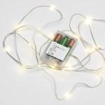 Les lumières micro LED AGL à piles de 2.3m et leur boitier d'alimentation.