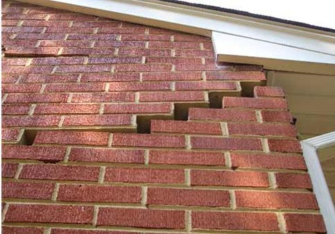 Tuckpointing will not repair the foundation damage this house is experiencing