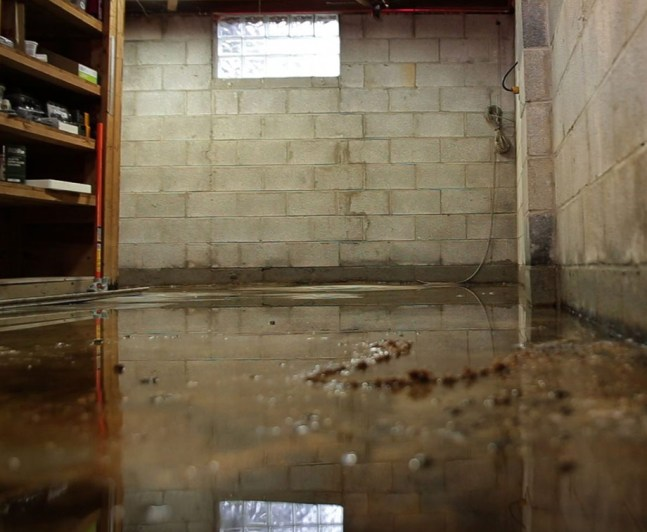 Flooded basement with block wall