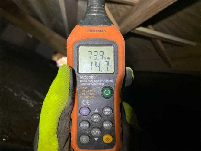 CFI checking humidity in crawl space