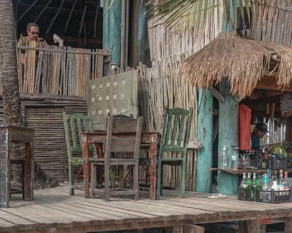Deck with colorful chairs at the taco stand
