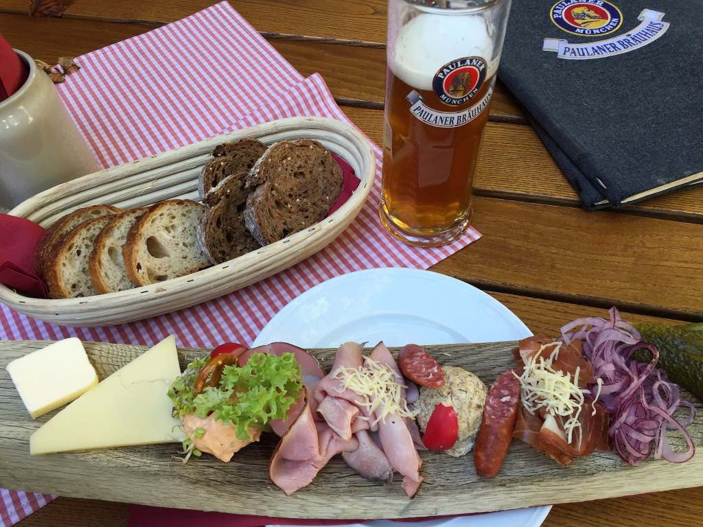 Meat and cheese platter and a beer