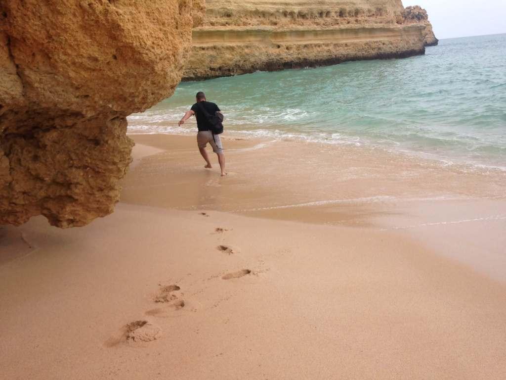 Man running away from a wave