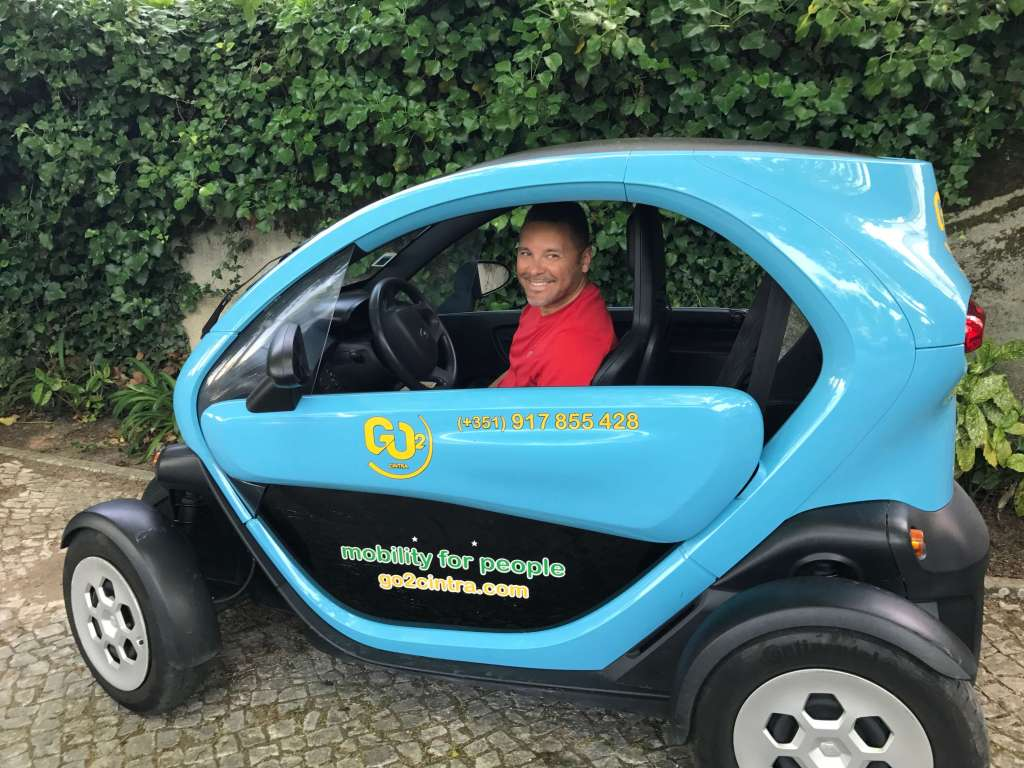 Zeke in a small electric car