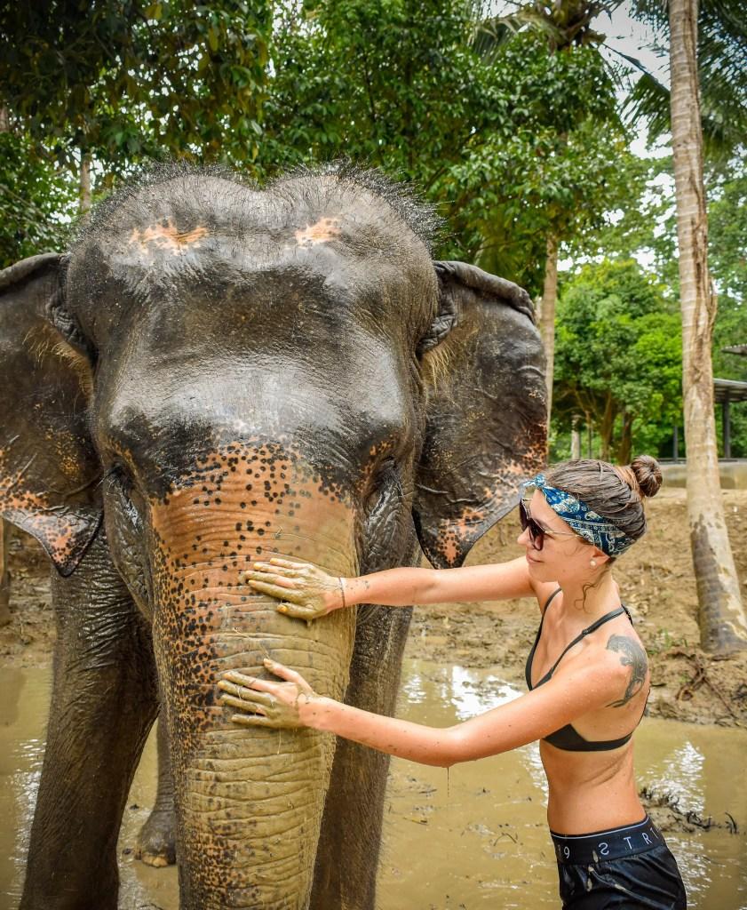 Alona Tiunina at an elephant sanctuary in Koh Samui Thailand. Jet Set Together About Me