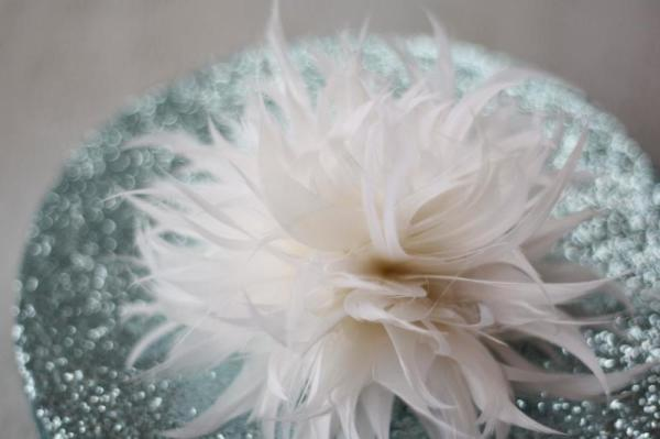 A tutorial on how to make a spider mum feather flower for bridal accessories