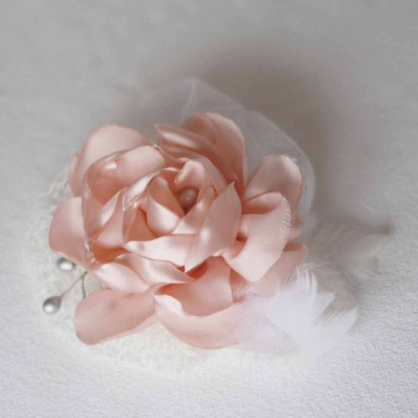 A fabric flower fascinator made with the help of the Layered Cabbage Rose Tutorial
