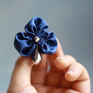 The Three Petal Fabric Flower is so versatile and stylish when made into accessories. Learn more how to make this fabric flower.