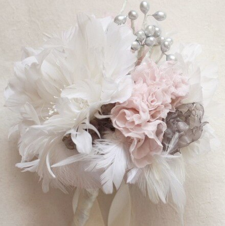 Create unique handmade bouquets from feather flowers and fabric flowers