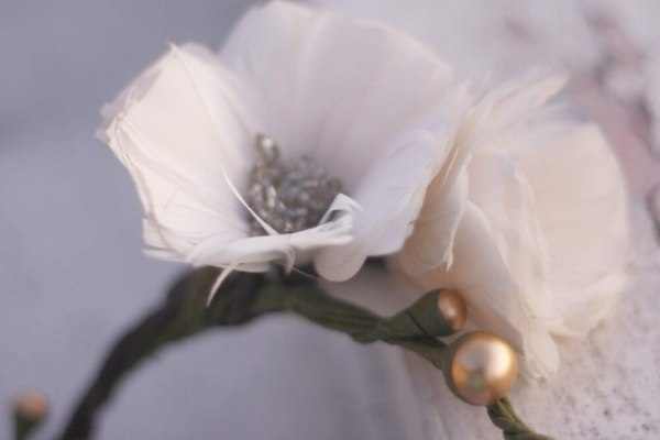 Closeup of hair crown make from feather poppy flowers
