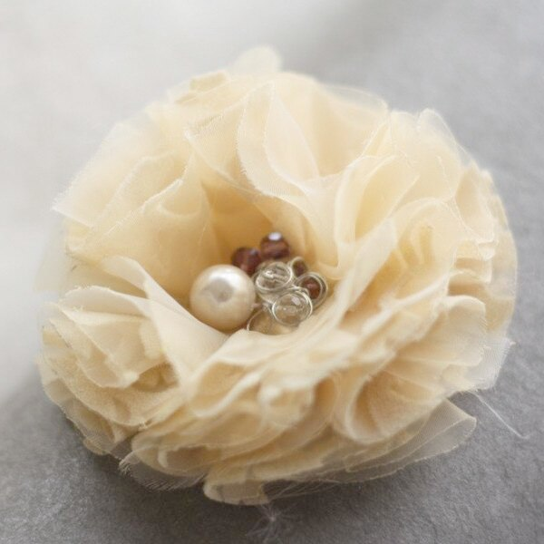 A yellow fabric flower with a beaded center | Carnation Flower Tutorial