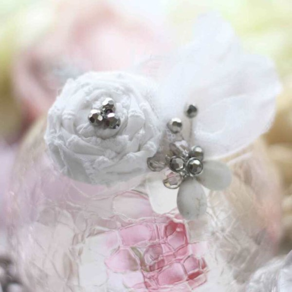 Rolled Rose Fabric Flower Tutorial with feathers and bead embellishments