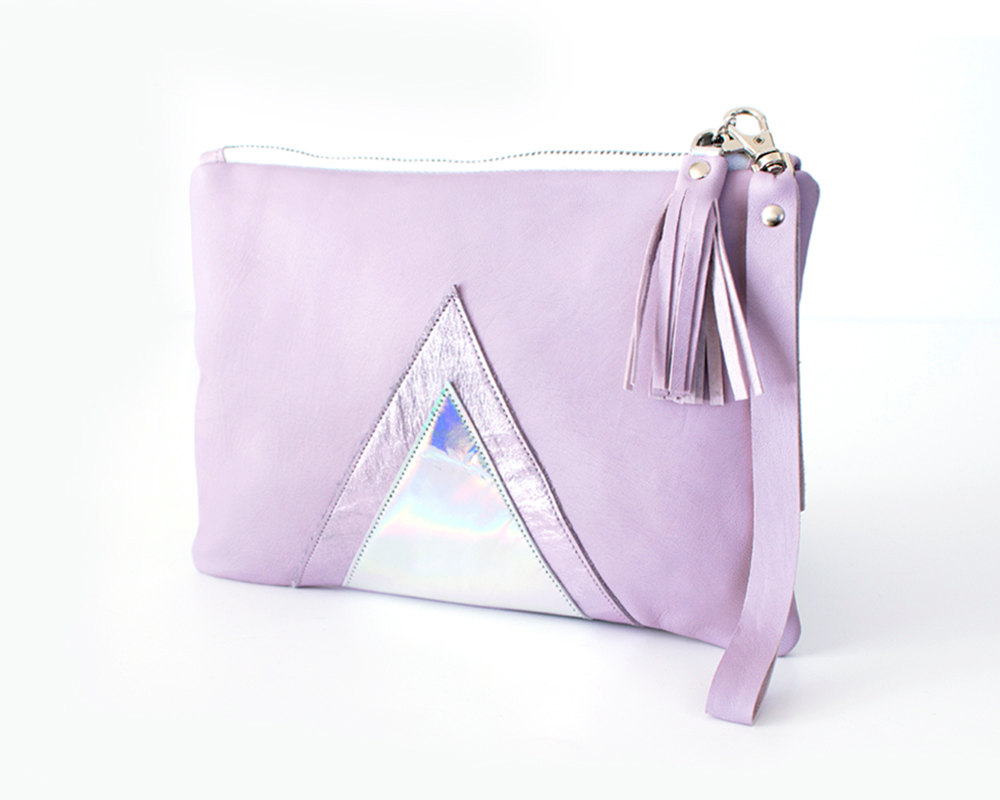 The front of a lavender leather wristlet with a triangular hologram panel from Gmalou Designs.