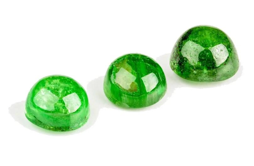 Three Tsavorite garnets cabochons in bright green