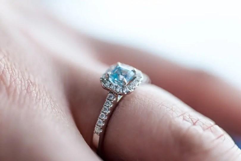 Blue zircon ring on woman finger