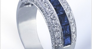 rincess cut Sapphires are beautifully accompanied by .70 ct. tw. Round Diamonds in this Sapphire Diamond wedding band