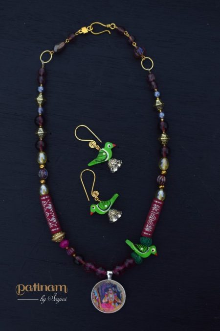 Andal and parrot necklace