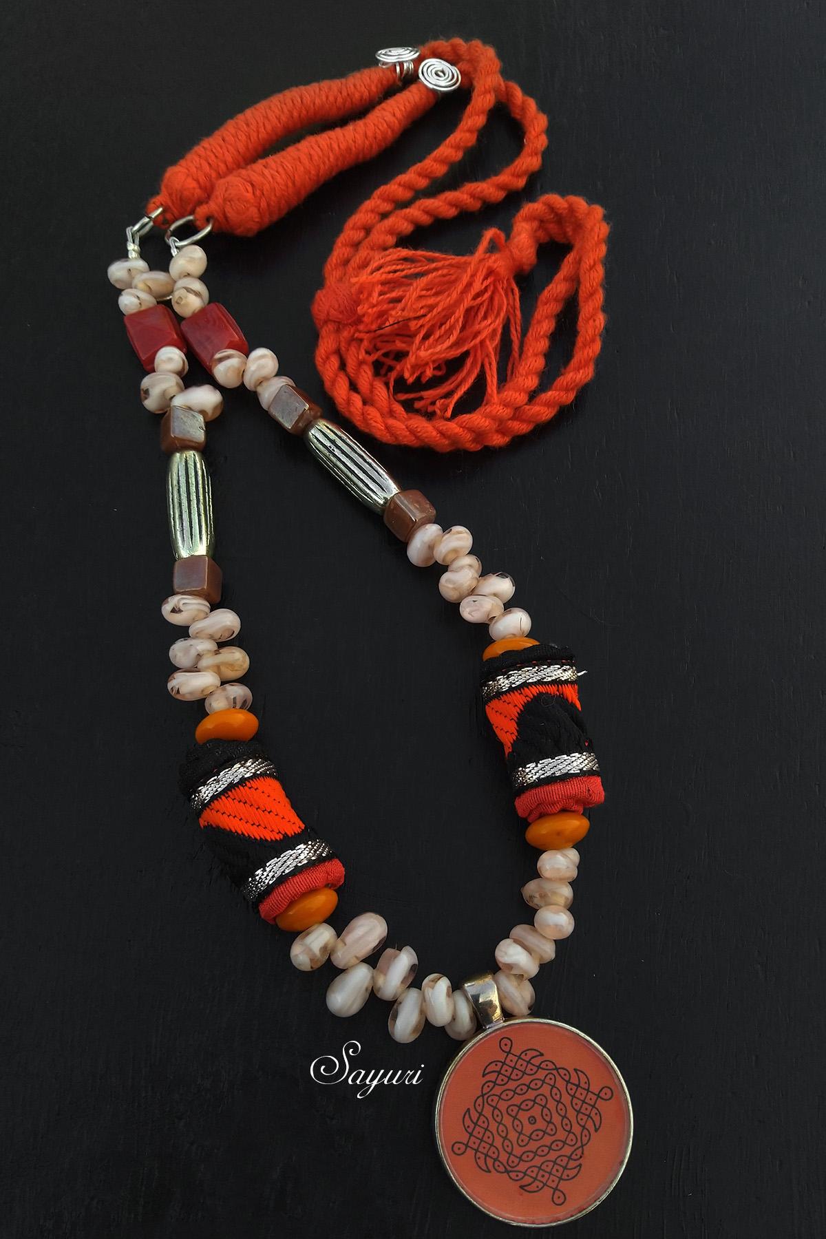 orange kolam necklace
