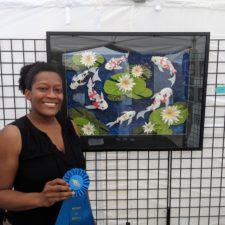 Juliana Jones wins the Octagon Arts Festival Booth Award