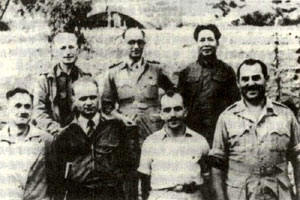 Israel Epstein, second from right in front, standing in front of Mao. He later became of his ministers of state, an extremely powerful position. To the right of him is another Jew, also under cover as a journalist.