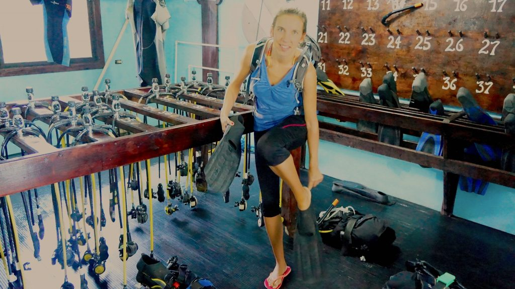 Trying on the equipment of the Parrot Dive Center.