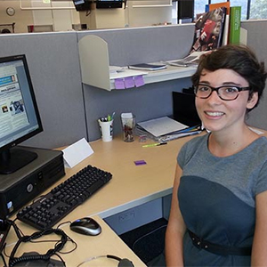 image of young woman volunteering in office
