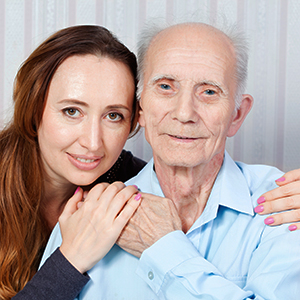 young woman volunteer companion with senior man