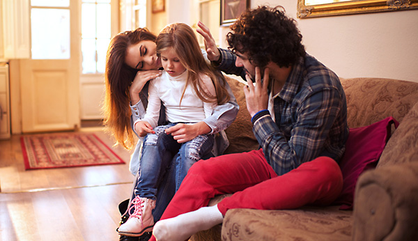 Parents comforting child