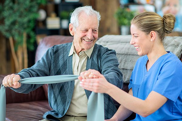 Physical Therapist with senior client