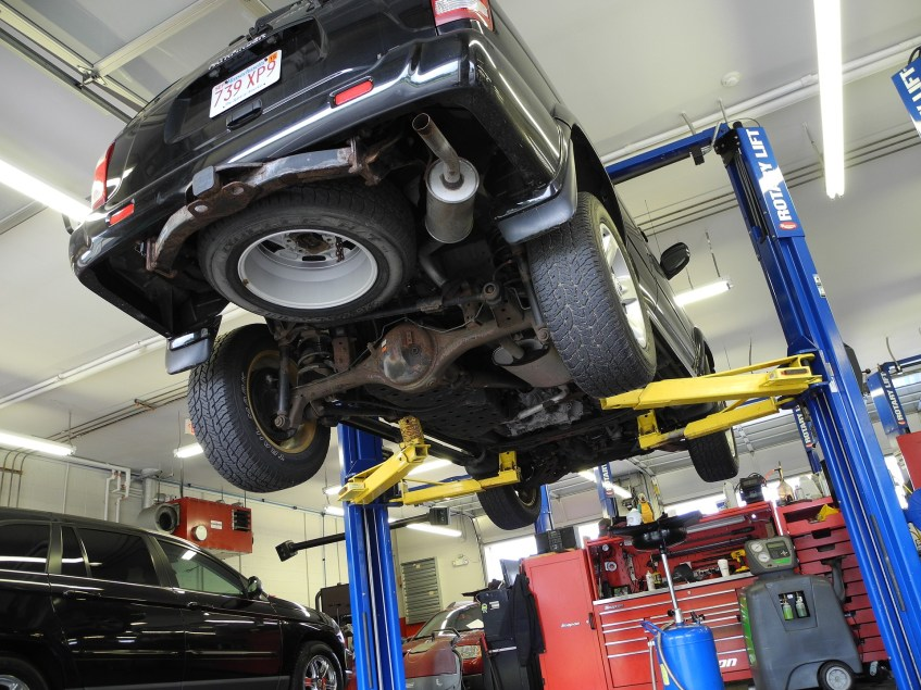 Car lifted in an auto shop