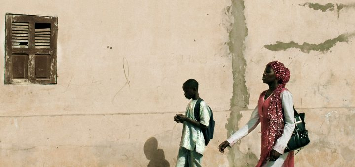 Young Woman and Teen-Age Boy on Sidewalk, St. Louis, Senegal