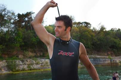zipping up wetsuit at barton springs