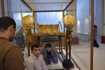 Checking the condition of Tut's ritual bed