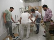 Mr. Hashizume and Egyptian wall-painting team making the base for wall-paintings together