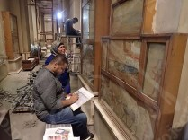 Mural painting team making condition survey