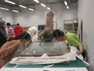 Fumigation team inspecting the condition of the textile artifacts before fumigation
