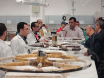Mr. Eissa and conservators in Wood Laboratory checking the unpacked wheel