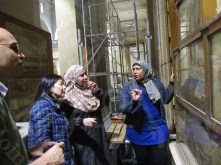 The curators inspect the wall paintings at the Egyptian Museum, AlTahrir