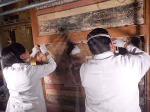 conservators inspect the mural paintings