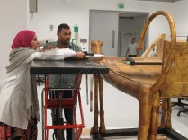 Conservators preparing for the X-Ray photography device
