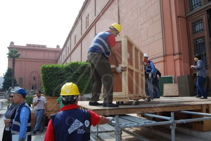 the transportation team prepares for moving the boxes into the transporting trucks