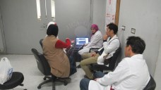 Experts monitor the X-ray radiography safely outside the lab.
