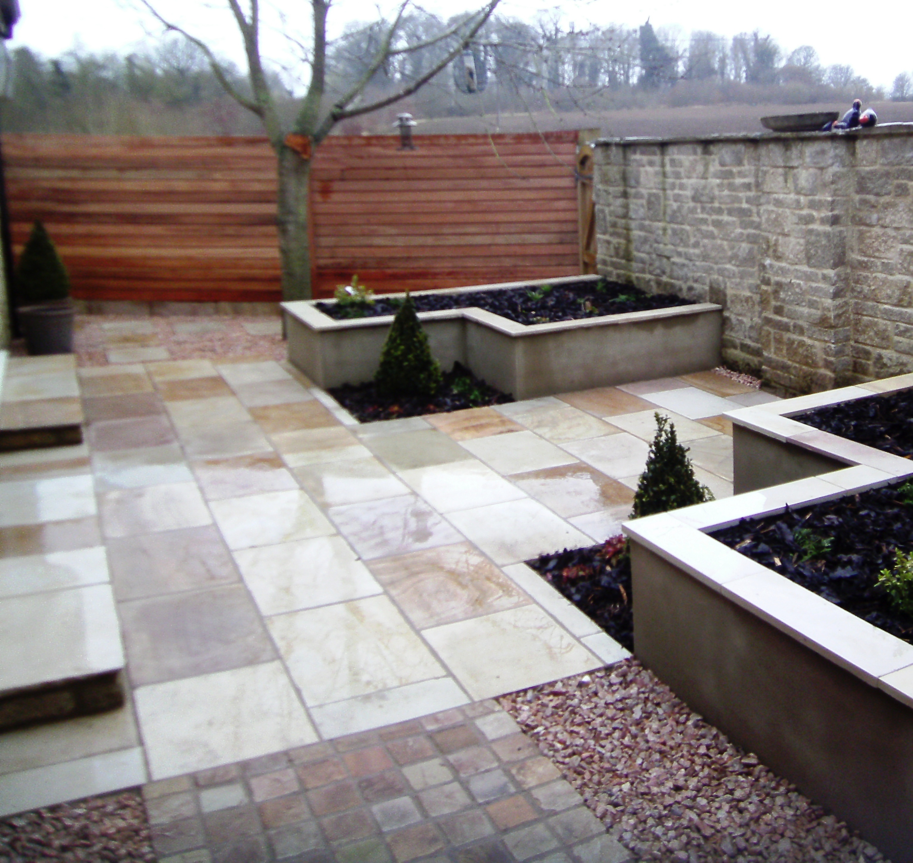 Contemporary garden design fairford gloucestershire for Suzhou architecture gardens landscape planning design company limited