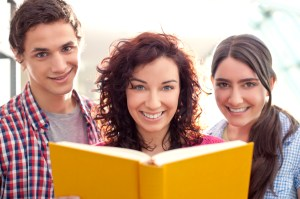 Mom with two teens reading