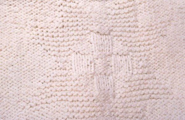 Searches: Sheriff's vest has a reverse stockinette stitch body