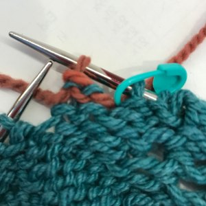 Bind off Within Row: 2) first stitch bound off (after k2)