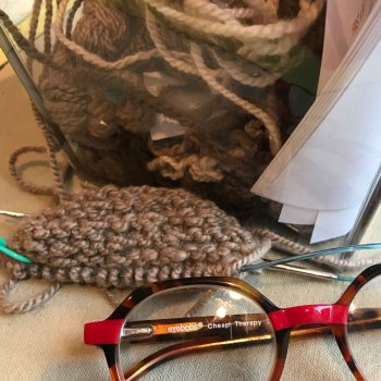 Yarn, pattern, swatch, and reading glasses that are named Cheap Therapy