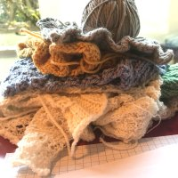 First Becoming: A teetering pile of swatches in Elemental Affects yarns