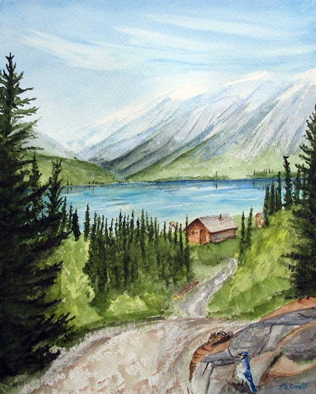 Cabin by mountain lake