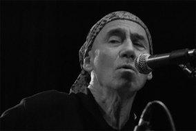BW closeup of Jim, singing